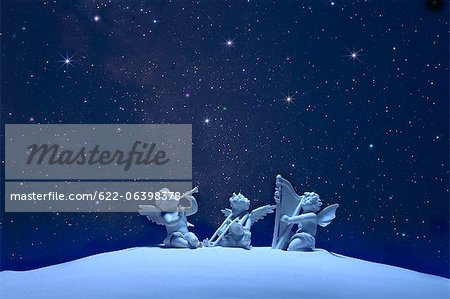 Three angels and stars Stock Photo - Premium Royalty-Free, Image code: 622-06398378