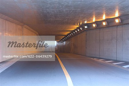 Lighted tunnel under the highway Stock Photo - Premium Royalty-Free, Image code: 622-06439279