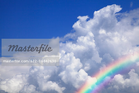 Blue sky with clouds and rainbow Stock Photo - Premium Royalty-Free, Image code: 622-06842630
