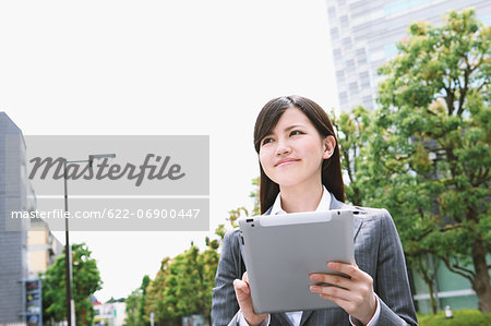 Businesswoman with tablet Stock Photo - Premium Royalty-Free, Image code: 622-06900447