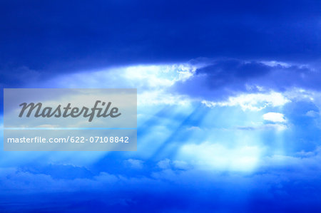Glow through clouds Stock Photo - Premium Royalty-Free, Image code: 622-07108842