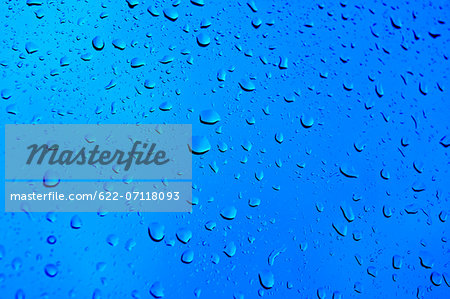 Raindrops on glass Stock Photo - Premium Royalty-Free, Image code: 622-07118093