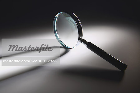 Magnifying glass Stock Photo - Premium Royalty-Free, Image code: 622-08122922