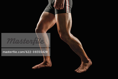 Japanese male athlete showing off muscles Stock Photo - Premium Royalty-Free, Image code: 622-08355428