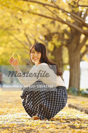 Young Japanese woman in a city park Stock Photo - Premium Royalty-Free, Image code: 622-08542967