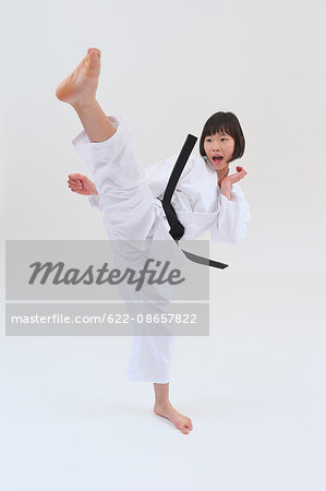 Japanese kid in karate uniform on white background Stock Photo - Premium Royalty-Free, Image code: 622-08657822