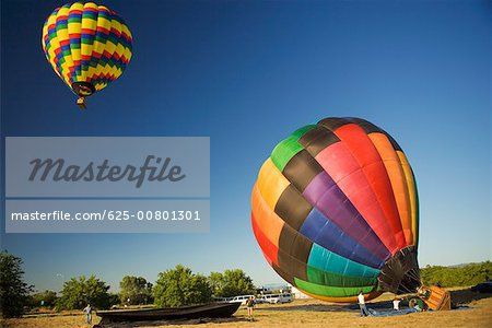Hot air balloon preparing to take off Stock Photo - Premium Royalty-Free, Image code: 625-00801301