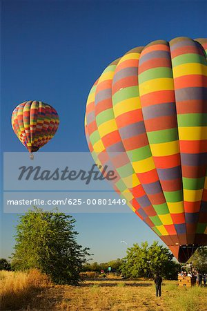 Hot air balloons preparing to take off Stock Photo - Premium Royalty-Free, Image code: 625-00801449