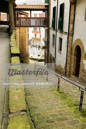 High angle view of an empty alleyway leading to the street, Spain Stock Photo - Premium Royalty-Free, Image code: 625-00804501
