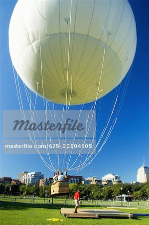 Hot air balloon taking off, Boston, Massachusetts, USA Stock Photo - Premium Royalty-Free, Image code: 625-00804505