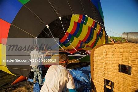 Rear view of two mid adult men near hot air balloon Stock Photo - Premium Royalty-Free, Image code: 625-00805513