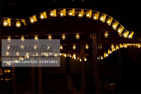 Lights on a carousel in an amusement park at night, San Diego, California, USA