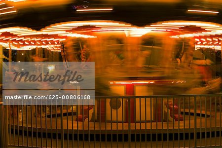 Carousel in an amusement park at night, San Diego, California, USA