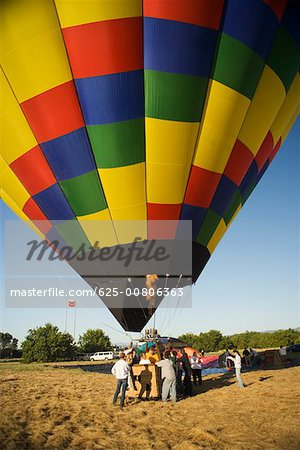 Hot air balloon preparing to take off Stock Photo - Premium Royalty-Free, Image code: 625-00806363