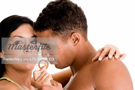 Close-up of a young couple holding a condom Stock Photo - Premium Royalty-Free, Image code: 625-00841273
