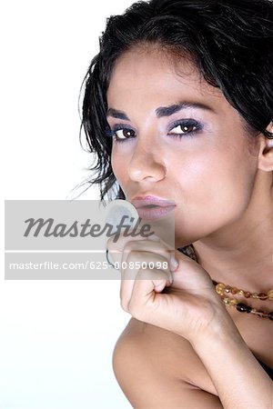 Portrait of a young woman holding a condom Stock Photo - Premium Royalty-Free, Image code: 625-00850098