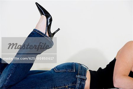 Close-up of a woman wearing stilettos Stock Photo - Premium Royalty-Free, Image code: 625-00850617