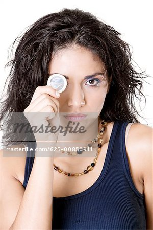 Portrait of a young woman holding a condom Stock Photo - Premium Royalty-Free, Image code: 625-00850911