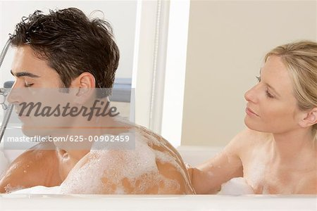 Close-up of a young couple in a bathtub Stock Photo - Premium Royalty-Free, Image code: 625-00902459