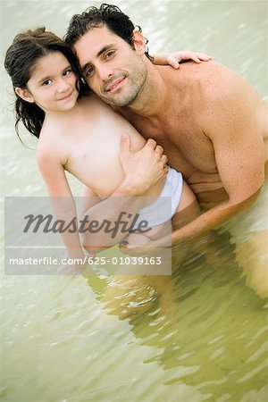 Portrait of a father hugging his daughter Stock Photo - Premium Royalty-Free, Image code: 625-01039163