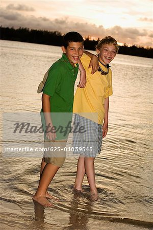 Portrait of two boys standing on the beach Stock Photo - Premium Royalty-Free, Image code: 625-01039545