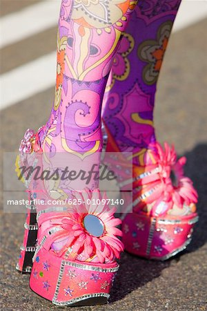 Close-up of a person's painted legs in high heels Stock Photo - Premium Royalty-Free, Image code: 625-01097140