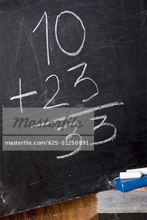 Close-up of mathematical addition on a blackboard Stock Photo - Premium Royalty-Free, Image code: 625-01250891