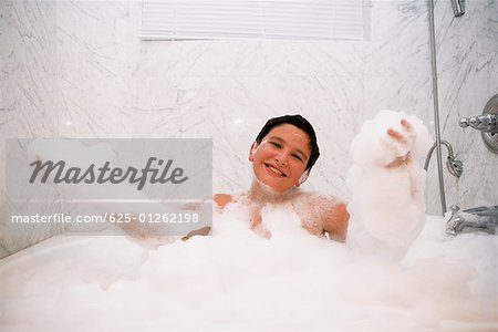 Portrait of a boy in a bubble bath Stock Photo - Premium Royalty-Free, Image code: 625-01262198