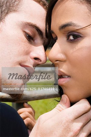 Close-up of a young man about to kiss a teenage girl Stock Photo - Premium Royalty-Free, Image code: 625-01746499