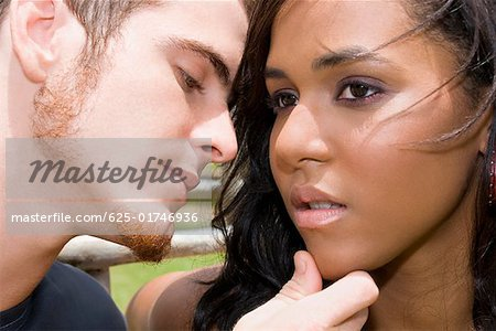 Close-up of a young man about to kiss a teenage girl Stock Photo - Premium Royalty-Free, Image code: 625-01746936