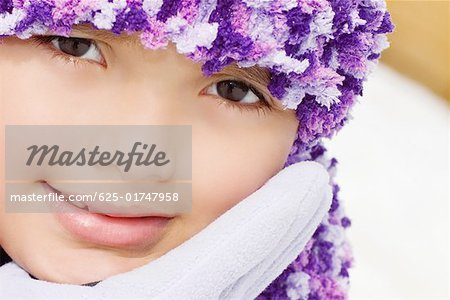 Portrait of a girl smiling with her hand on her chin Stock Photo - Premium Royalty-Free, Image code: 625-01747958