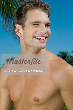 Close-up of a young man smiling Stock Photo - Premium Royalty-Free, Image code: 625-01748144
