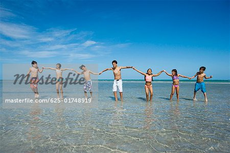 Children playing with holding each other hands on the beach Stock Photo - Premium Royalty-Free, Image code: 625-01748919