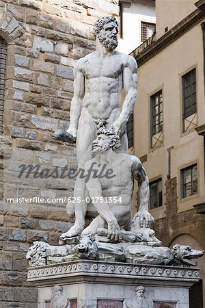 Naked statues in front of a brick wall, Hercules and Caco, Piazza della Signoria, Florence, Italy