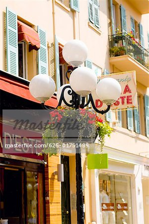 Lamppost in front of a building, Nice, France Stock Photo - Premium Royalty-Free, Image code: 625-01751489