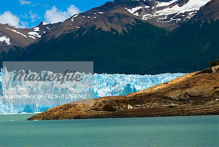 Glaciers in front of mountains, Moreno Glacier, Argentine Glaciers National Park, Lake Argentino, El Calafate, Patagonia Stock Photo - Premium Royalty-Free, Image code: 625-01751742