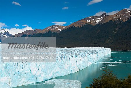Glacier in a lake with mountains in the background, Moreno Glacier Argentine Glaciers National Park, Lake Argentino, El Calafate, Stock Photo - Premium Royalty-Free, Image code: 625-01751743