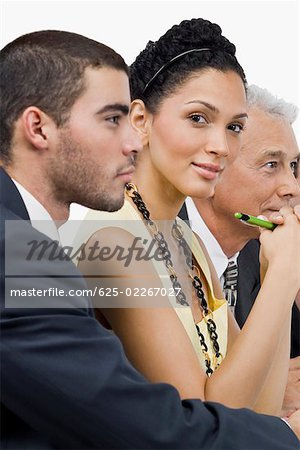 Two businessmen and a businesswoman at a meeting in a conference room Stock Photo - Premium Royalty-Free, Image code: 625-02267027