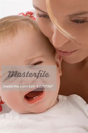 Close-up of a mid adult woman consoling her son Stock Photo - Premium Royalty-Free, Image code: 625-02267367