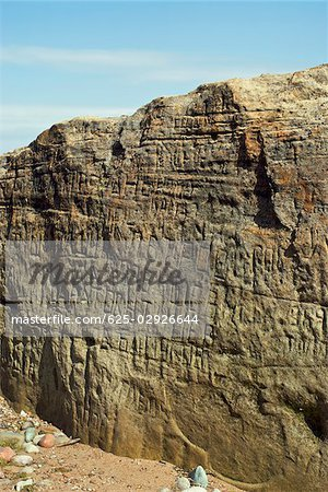 Script carved on a rock Stock Photo - Premium Royalty-Free, Image code: 625-02926644