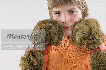 Portrait of a boy imitating to be a boxer Stock Photo - Premium Royalty-Free, Image code: 625-02926964