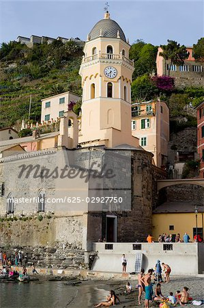 Low angle view of a church in a town, Church of Santa Margherita d'Antiochia, Italian Riviera, Cinque Terre National Park, Vernazza, La Spezia, Liguria, Italy Stock Photo - Premium Royalty-Free, Image code: 625-02927750