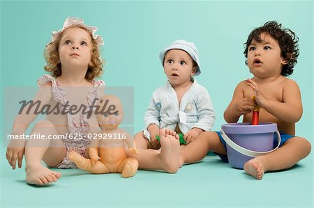 Three children playing with toys Stock Photo - Premium Royalty-Free, Image code: 625-02929316