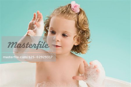 Close-up of a girl bathing in a bathtub Stock Photo - Premium Royalty-Free, Image code: 625-02929317
