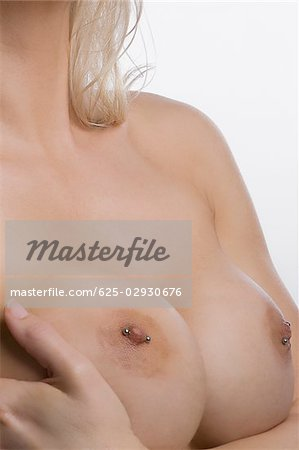 Mid section view of a naked young woman Stock Photo - Premium Royalty-Free, Image code: 625-02930676