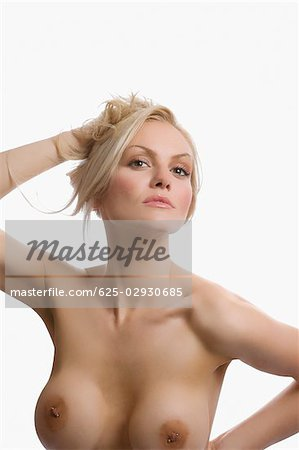 Portrait of naked young woman posing Stock Photo - Premium Royalty-Free, Image code: 625-02930685