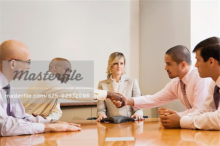 Business executives in a board room Stock Photo - Premium Royalty-Free, Image code: 625-02932088