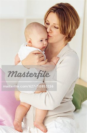 Close-up of mother holding baby boy (6-12 months) Stock Photo - Premium Royalty-Free, Image code: 627-00853156