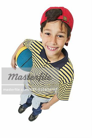 Elevated view of a boy (11-12) holding basketball Stock Photo - Premium Royalty-Free, Image code: 627-01063878