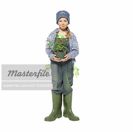 Close up portrait of a girl (11- 12) holding a pot plant Stock Photo - Premium Royalty-Free, Image code: 627-01064817